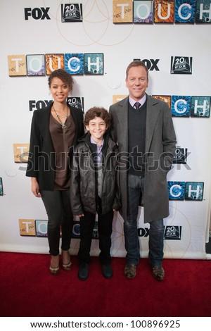NORTH HOLLYWOOD, CA - APRIL 23: Gugu Mbatha-Raw, David Mazouz & Kiefer Sutherland attend Fox's new series 'Touch' screening at Leonard Goldenson Theatre on April 23, 2012 in North Hollywood, CA.