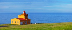 North Iceland Sea Landscape with Orange Lighthouse and Blue Sky. Panorama