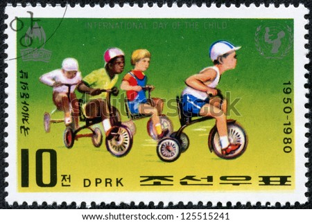 NORTH KOREA - CIRCA 1980: A stamp printed in North Korea commemorates International Children's day showing children Playing, circa 1980.