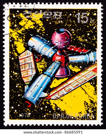 NORTH KOREA - CIRCA 1976:  A stamp printed in North Korea shows a futuristic looking space station against a sea of stars and the Milky Way galaxy, circa 1976.