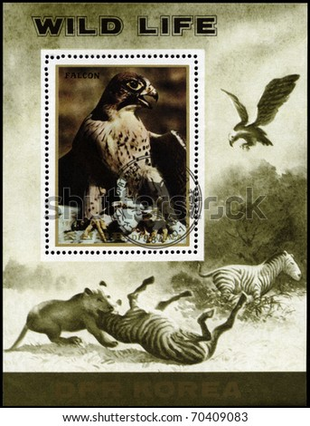 "NORTH KOREA - CIRCA 1984: A Stamp sheet printed in NORTH KOREA shows image of  a Eagle and Lion preying on Zebra from the series ""Wild Animals"", circa 1984"