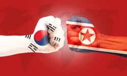 North Korea, vs South Korea concept, hands painted North Korea flag and outh Korea flag on red world map background