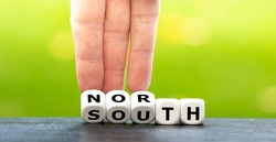 North or south? Hand turns dice and changes the word