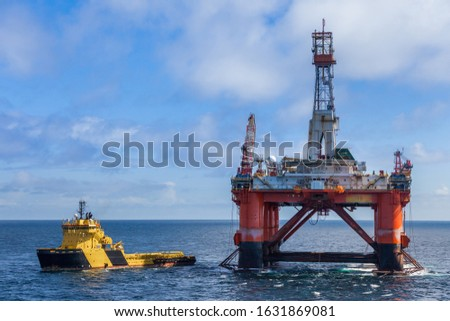 NORTH SEA NORWAY - 2015 MAY 25. The semi-submersible drilling rig Transocean Leader with anchor handler vessel Balder Viking alongside.