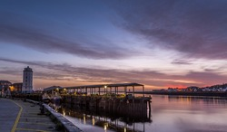 North Shields Fish Quay on a calm morning during a vivid sunrise with moored Fishing boats