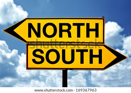 North versus south, opposite direction signs