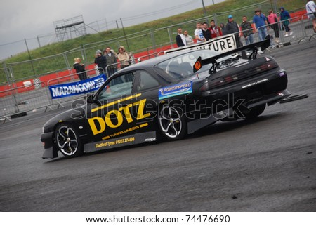 NORTHANTS, ENGLAND - AUG 2: Black Nissan Dotz Drift Car on display at the Annual Ultimate Street Car Show on August 2, 2008 in Northants, England, UK. Santa Pod is host to the show