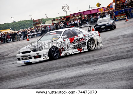 NORTHANTS, ENGLAND - AUG 2: White Nissan Drift Car with Decals on display at the Annual Ultimate Street Car Show on August 2, 2008 in Northants, England, UK. Santa Pod is host to the show