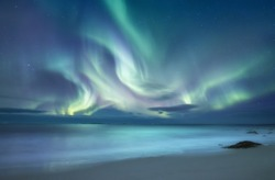 Northen light above ocean. Beautiful natural landscape in the Norway