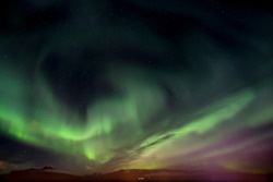 Northen light aurora dancing in Akureyri Iceland