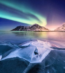 Northen light on the arctic beach. Beautiful natural landscape in the Norway