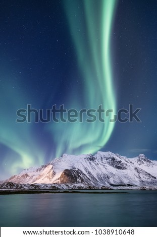 Northen light under mountains. Beautiful natural landscape in the Norway #1038910648
