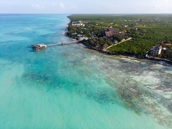Northern Coast of Zanzibar at Nungwi with Lighthouse and Thatched-roof Restaurant on Pillars Above the Ocean