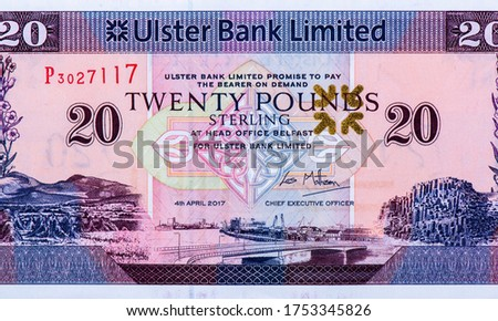 Northern Irish banknote features a view on Belfast harbour. Portrait from Northern Ireland 20 Pounds 1990-2012 Banknotes. An Old paper banknote, vintage retro. Famous ancient Banknotes. Collection.