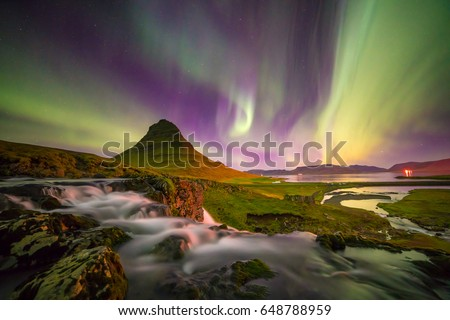 Northern light over Kirkjufell mountain in iceland #648788959