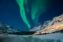 Northern lights above Ersfjordbotn in Norway. Beautiful aurora borealis.