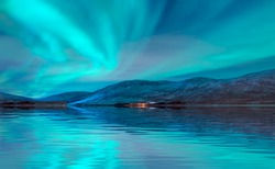 Northern lights (Aurora borealis) in the sky over Tromso fjords - Tromso,  Norway