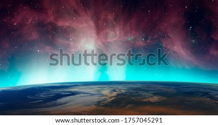 Northern lights aurora borealis over planet Earth in the background The Orion's Sword 'Elements of this image furnished by NASA Stock photo ©