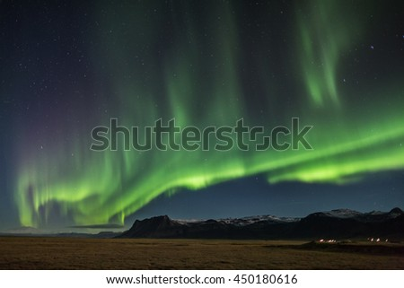 Northern Lights - Aurora borealis over Snaefellsnes peninsula in Iceland - Shutterstock ID 450180616