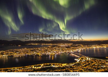 Northern lights (aurora borealis) over Tromso, Norway #580856695