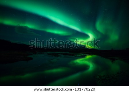 Northern lights (Aurora borealis) reflection across a lake in Iceland