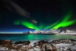 Northern lights explotion above Mt Himmeltinden in Lofoten archipelago