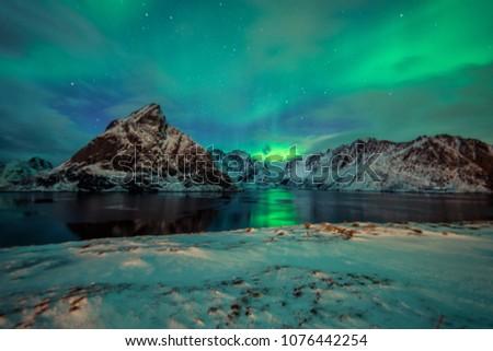 Northern Lights in the mountains of Reine, Norway.  Lofoten Islands #1076442254