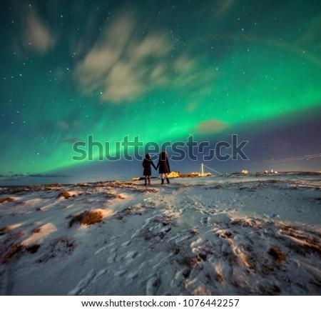 Northern Lights in the mountains of Reine, Norway.  Lofoten Islands #1076442257