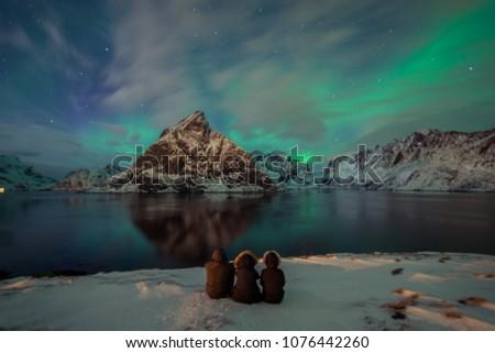 Northern Lights in the mountains of Reine, Norway.  Lofoten Islands #1076442260