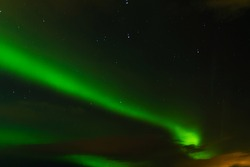 Northern lights in the night sky of iceland. Soft focus. Magical green glow