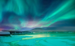 Northern lights or Aurora borealis in the sky over Tromso, Norway