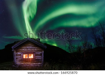 northern lights over an old...