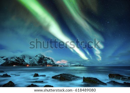 Northern Lights over the Lofoten Islands in Norway  #618489080