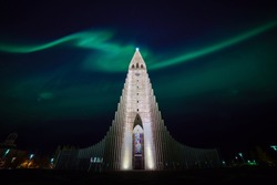 Northern lights shining over the church in Reykjavik Iceland