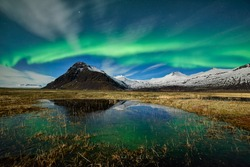 Northern lights. Spectacular aurora borealis display near the glacier lagoon Jokulsarlon in Iceland