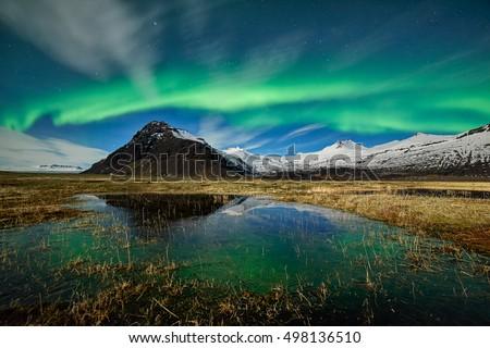 Northern lights. Spectacular aurora borealis display near the glacier lagoon Jokulsarlon in Iceland #498136510