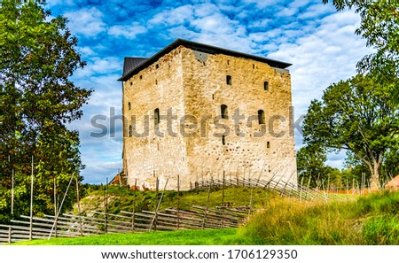 Photo of  Northern medieval fortress in forest. Fortress at North. Medieval fortress