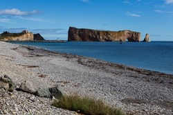 Northern view of the beach in quaint Percé village, with the Cape Canon, the wharf and the iconic Rocher Percé in the background, Quebec, Canada