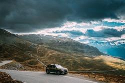 Norway. Car SUV Parked Near Aurlandsfjellet Scenic Route Road In Summer Norwegian Landscape. Natural Norwegian Landmark And Popular Destination.