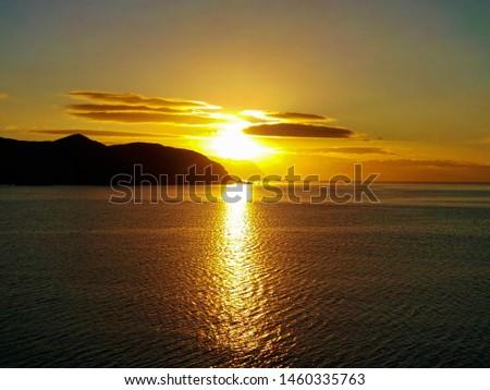 Norway, Finnmark, Magerøya island. Nordkapp: Fjord summer landascape with midnight sun