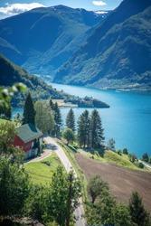 Norway fjord shore, Aurland fjord, beautiful Scandinavian landscape, travel to Norway, summer, vertical shot