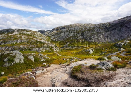 Norway - hiking in the amazing fjord mountains of Rogaland - near Lysebotn and Lysefjord, heading to Kjerag bolten - sunny day of summer