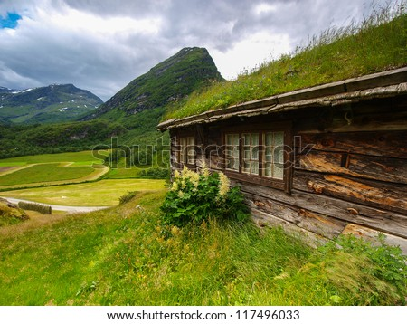 Norway landscape. Building with grass on the roof