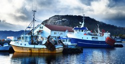 Norway marina with sailboats and fishingboats in a small village in the fjords