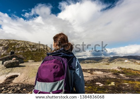 Norway mountain and fjord landscapes with female model and backpack