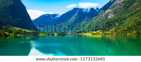 Norway Nordfjord fjord panoramic banner with glacier, forest mountains landscape and rural houses. Norwegian nature
