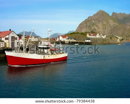 Norwegian boat on blue sea in lofoten island, Norway - stock photo