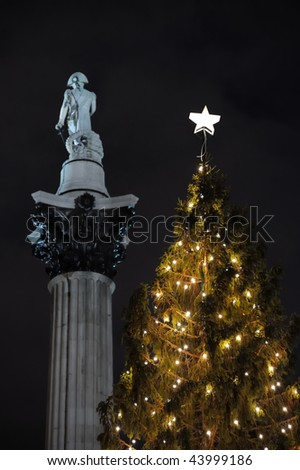 Norwegian Christmas Tree, Trafalgar Square, London, England, UK, Europe, with Nelson's Column in the background