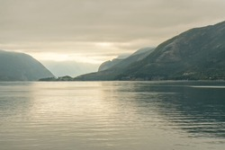 Norwegian fjords sea foggy sunset mountain landscape, Norway