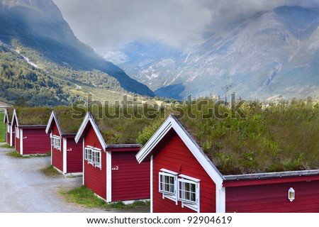 Norwegian houses in the mountains with green roofs